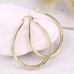 Yellow Gold Diamond Cut Oval Hoop Earrings